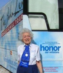 Helen standing with John Lennon Bus